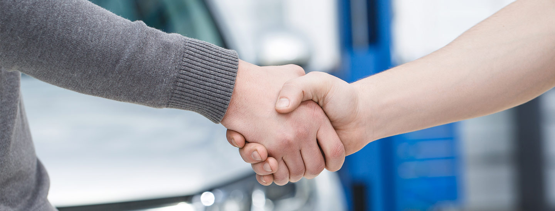 Lupient Automotive Group - Hand shake