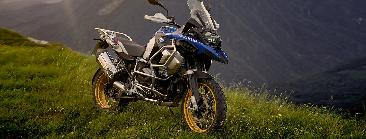 Side view of the 2020 BMW R 1250 GS Adventure parked on top of a hill