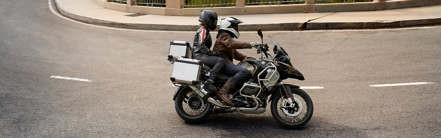 Side view of the 2020 BMW 1250 GS Adventure in motion during a turn