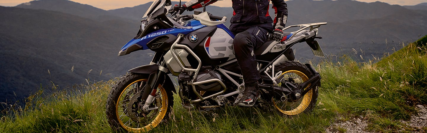 Side view of the 2020 BMW 1250 GS Adventure parked on the top of a hill