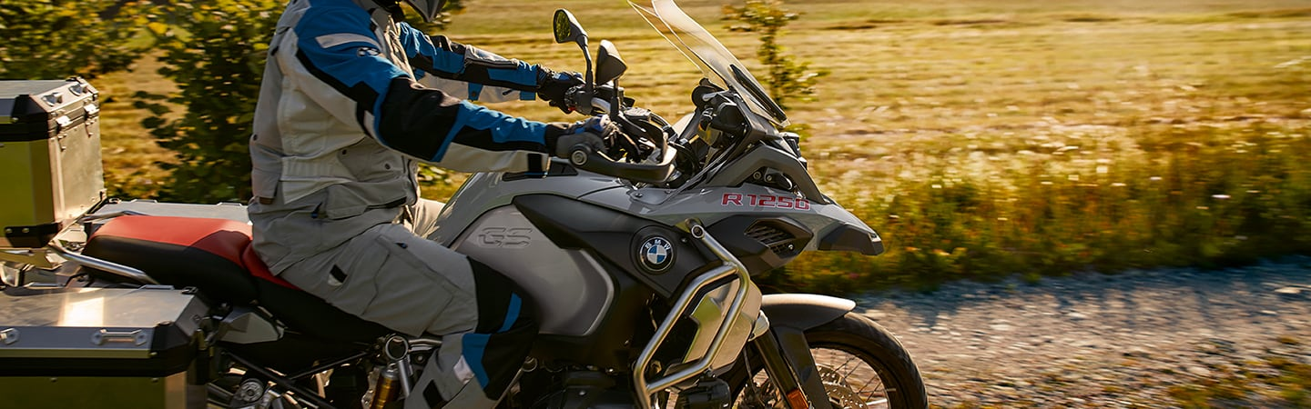 Side view of the 2020 BMW GS Adventure in motion through a field