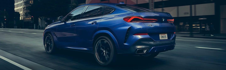 Blue 2020 BMW X6 in motion
