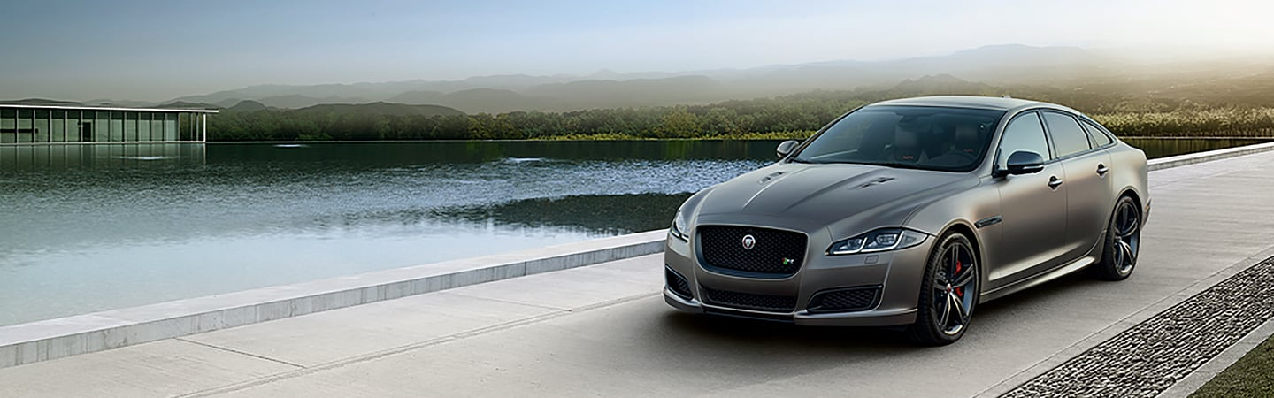 Front view of the 2019 Jaguar XJ in motion outside of the Jaguar Ocala