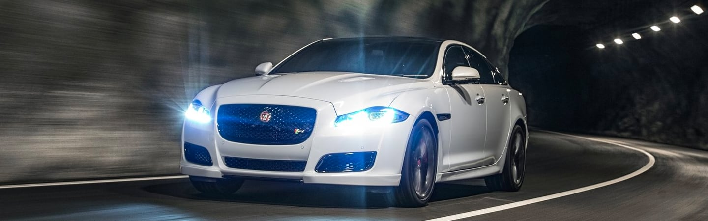 Front view of the 2019 Jaguar XJ in motion through a tunnel