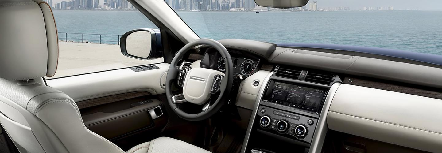 Drivers side seat and steering wheel of the 2020 Land Rover Range Rover Discovery