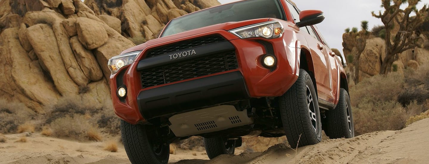 Red 2020 Toyota 4Runner driving on dirt