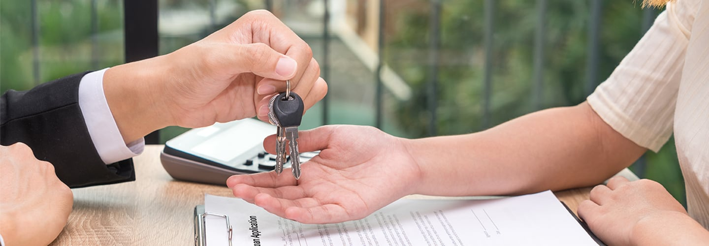 Keys being handed over to the new car owner