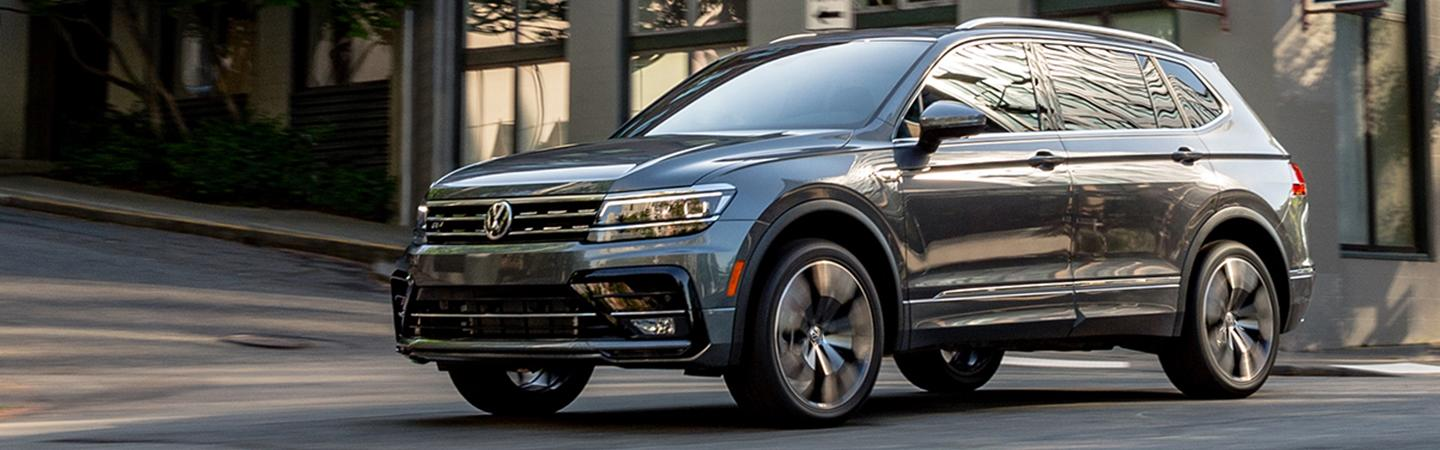 Side view of the front of the 2020 Volkswagen Tiguan parked on the street