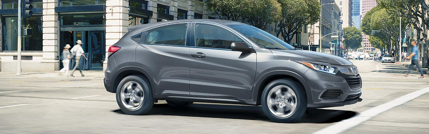 Side view of the 2020 Honda HR-V driving in the city