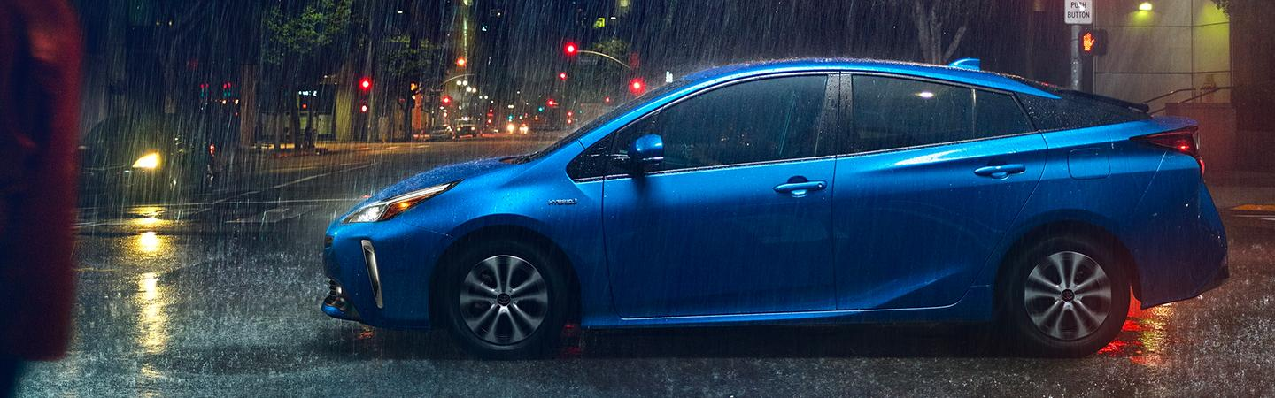 Blue 2020 Toyota Prius driving in the rain
