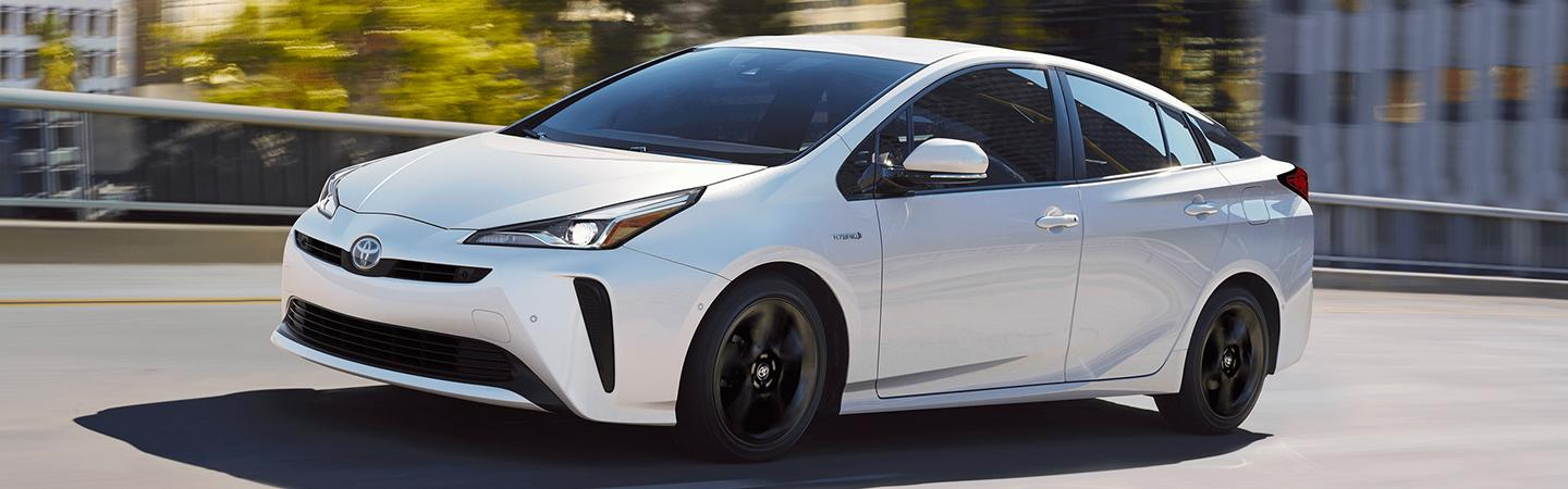 White 2020 Toyota Prius in motion