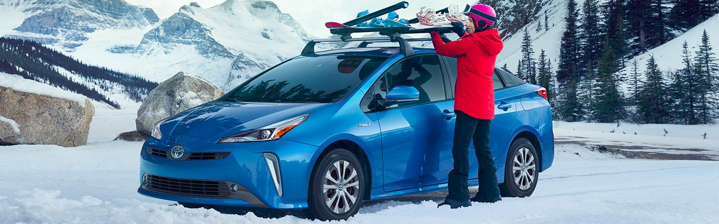 Blue 2020 Toyota Prius parked in the snow