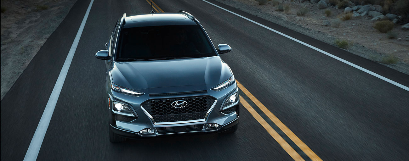 2019 Hyundai Kona front view driving one lane road.