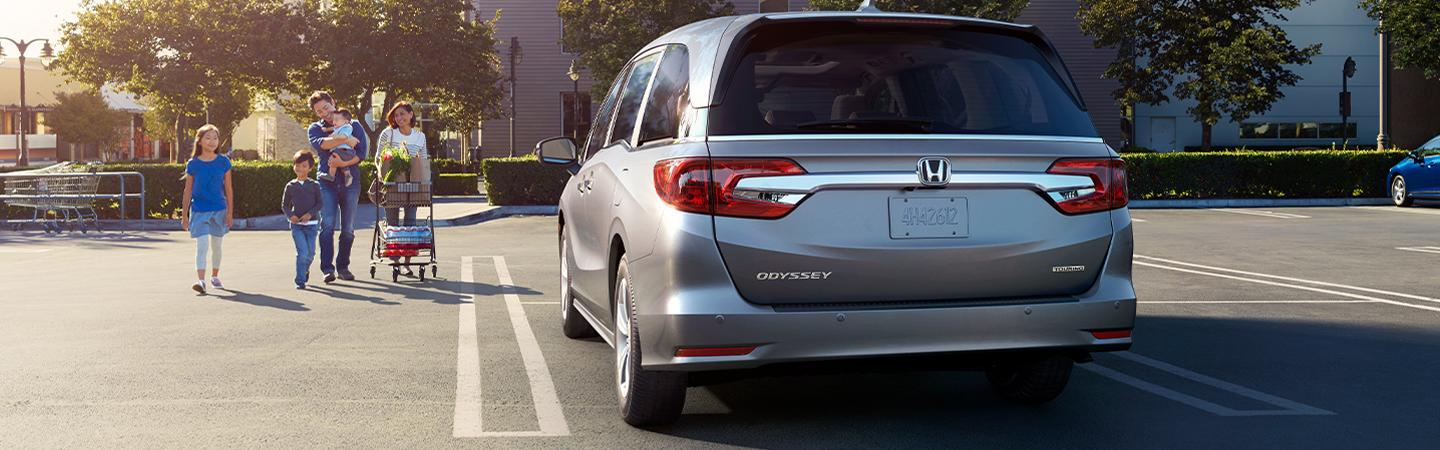 Rear view of the 2020 Honda Odyssey in motion on the road