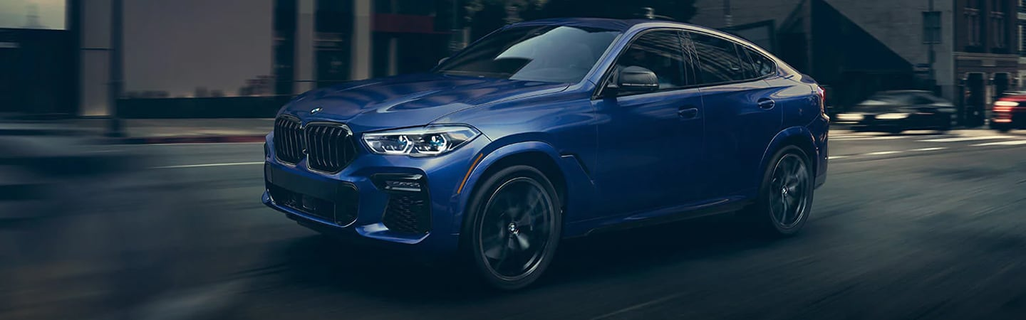 Blue 2020 BMW X6 in motion