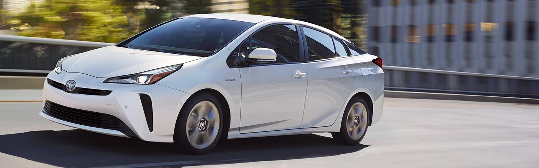 White 2020 Toyota Prius in motion