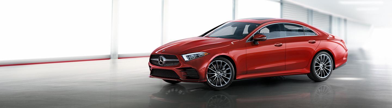 Red Mercedes-Benz sedan parked