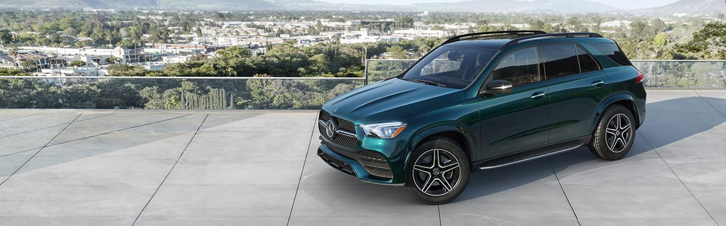 Green Mercedes-Benz GLE parked on a rooftop