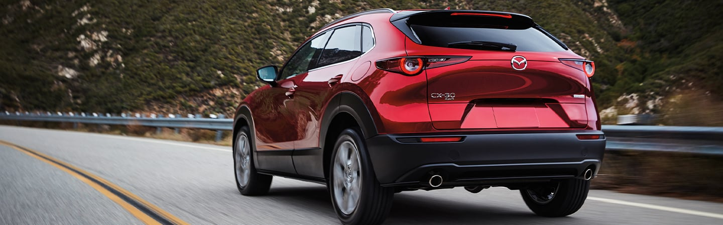 Rear view of the 2020 Mazda CX-30 in motion outside