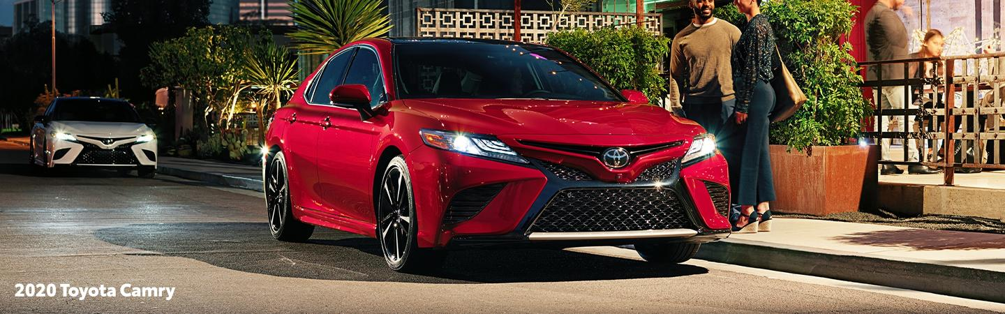 Red 2020 Toyota Camry parked on the street