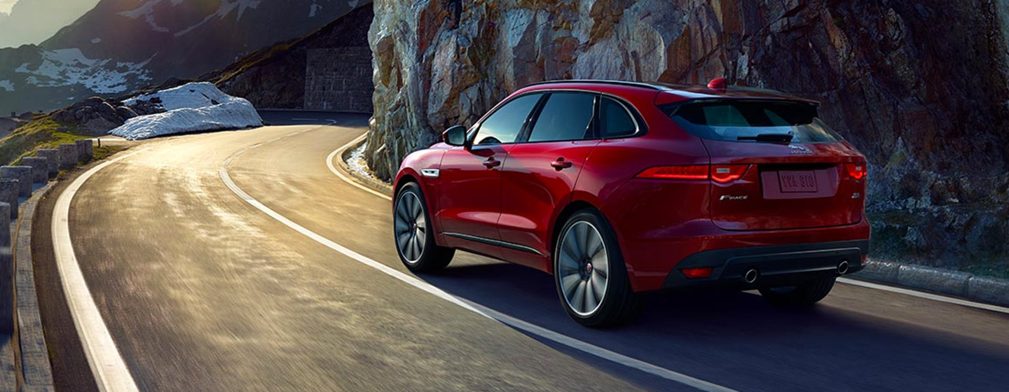 2019 Jaguar F-PACE rear back view on turn in motion.