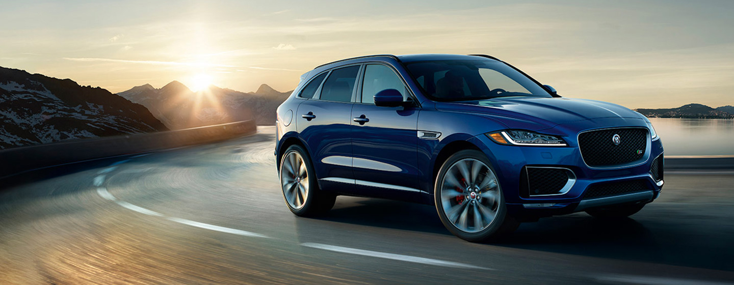 2019 Jaguar F-PACE passenger front view on turn in motion.