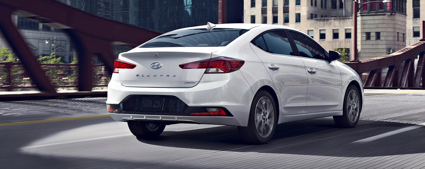 2019 Hyundai Elantra rear view in motion on bridge.