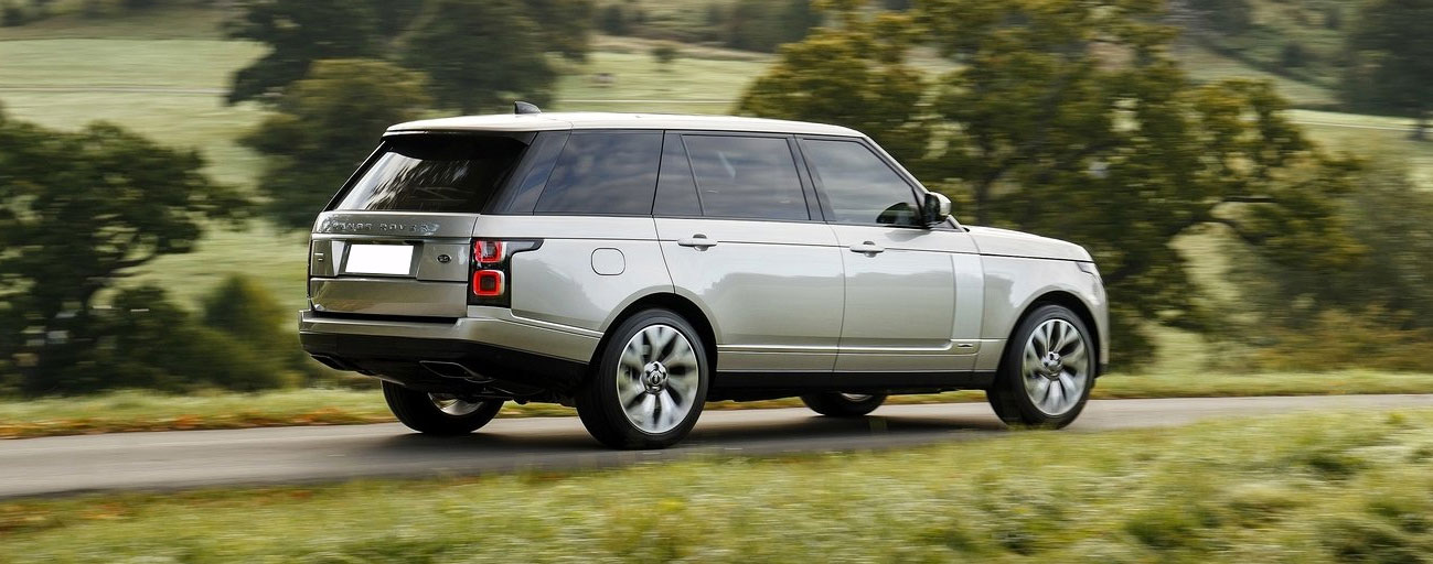 2019 Range Rover driving in country in motion view.