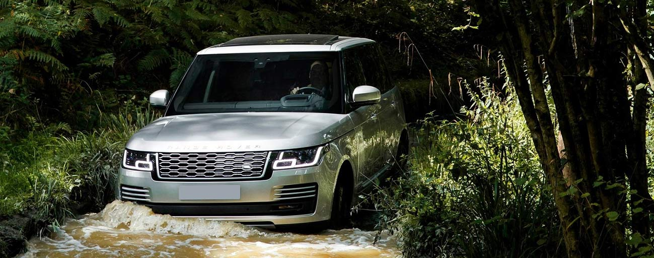 2019 Range Rover four wheel in creek.