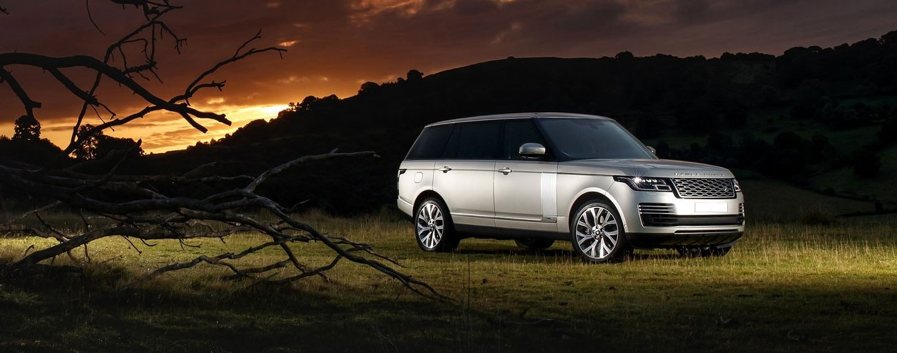 2019 Range Rover parked at sunset.