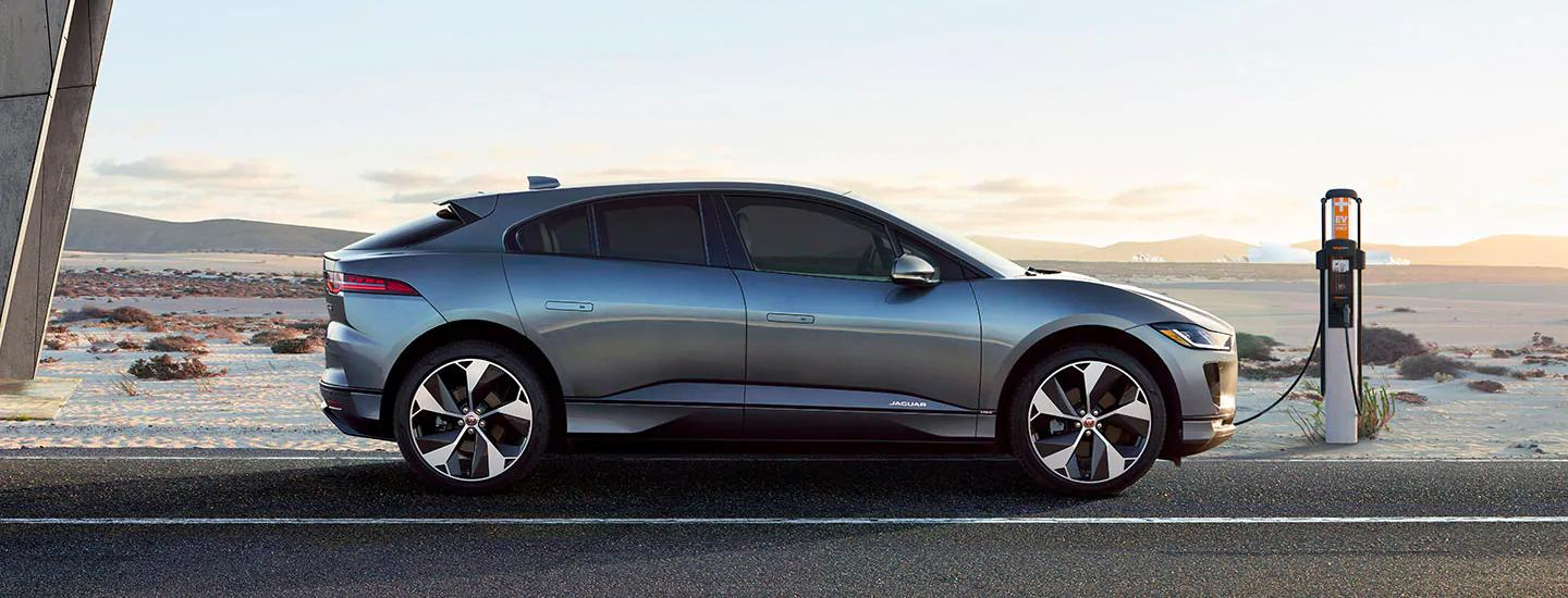 Side view of the 2020 Jaguar I-Pace parked outside charging