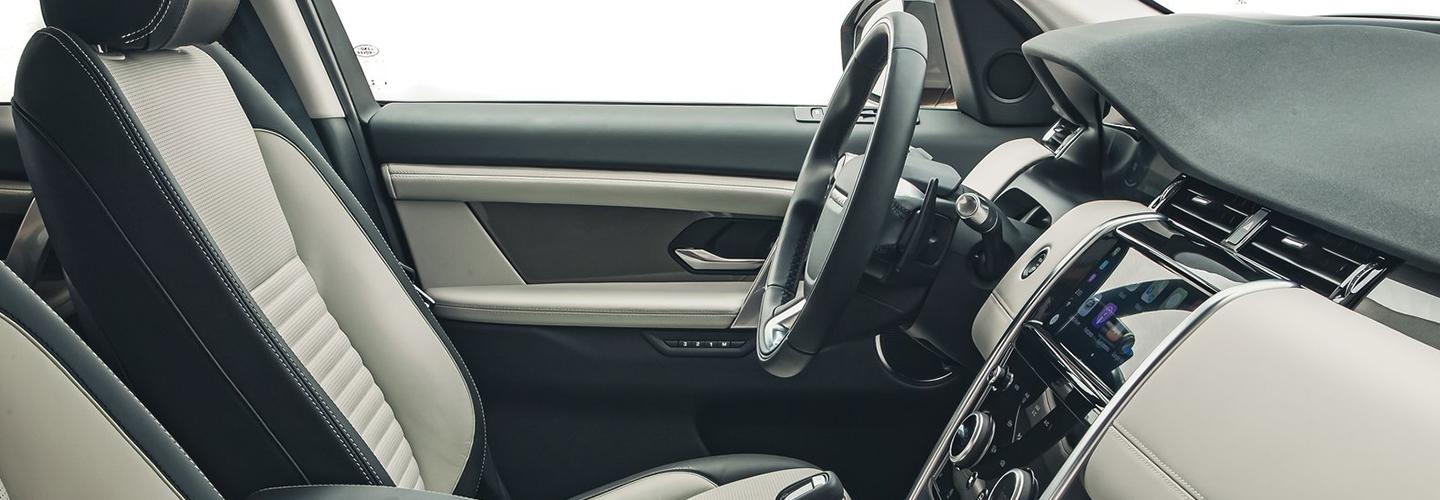 Interior view of the drivers side seat and steering wheel of the 2020 Land Rover Discovery Sport