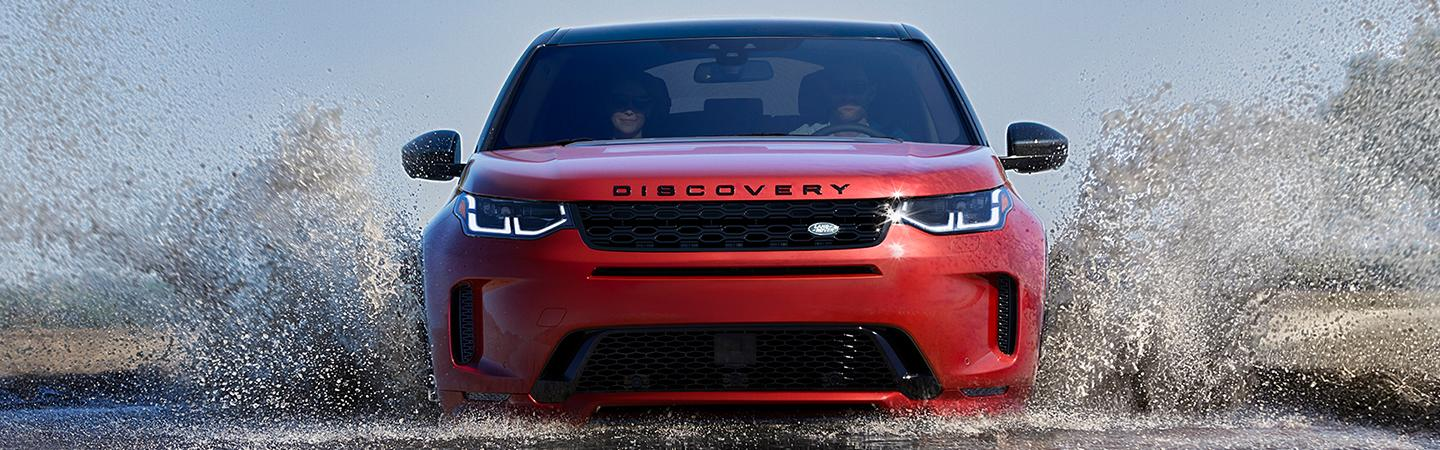 Front view of the 2020 Land Rover Discovery driving through water