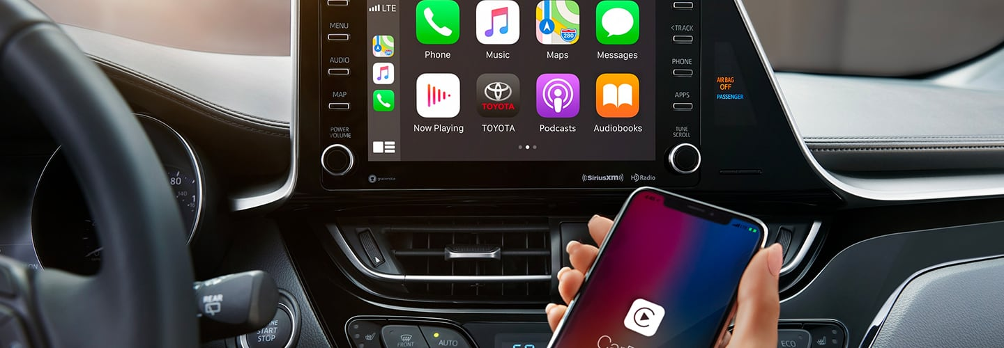 Interior touchscreen display system with driver using Apple CarPlay
