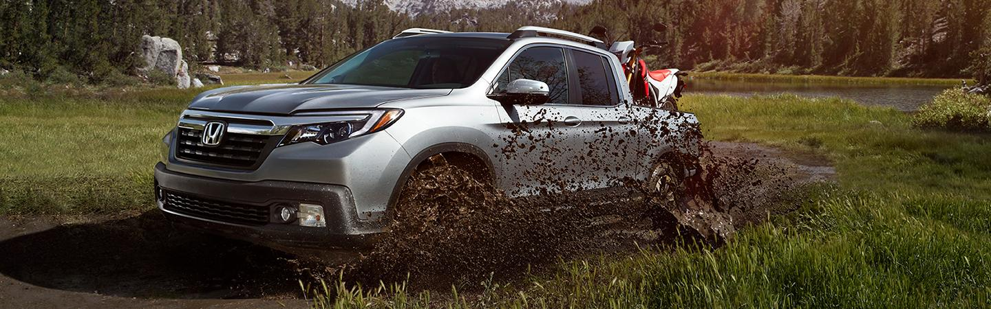 2020 Honda Ridgeline riding through mud