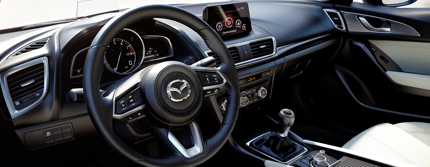 Safety features and interior of the 2018 Mazda3 - available at our Mazda dealership in Manchester, NH.