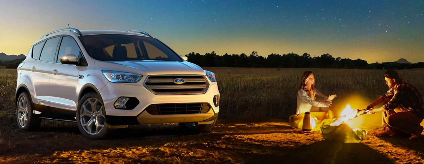 2019 Ford Escape parked in the country at a campfire.
