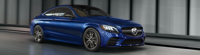 Blue Mercedes-Benz C-Class parked