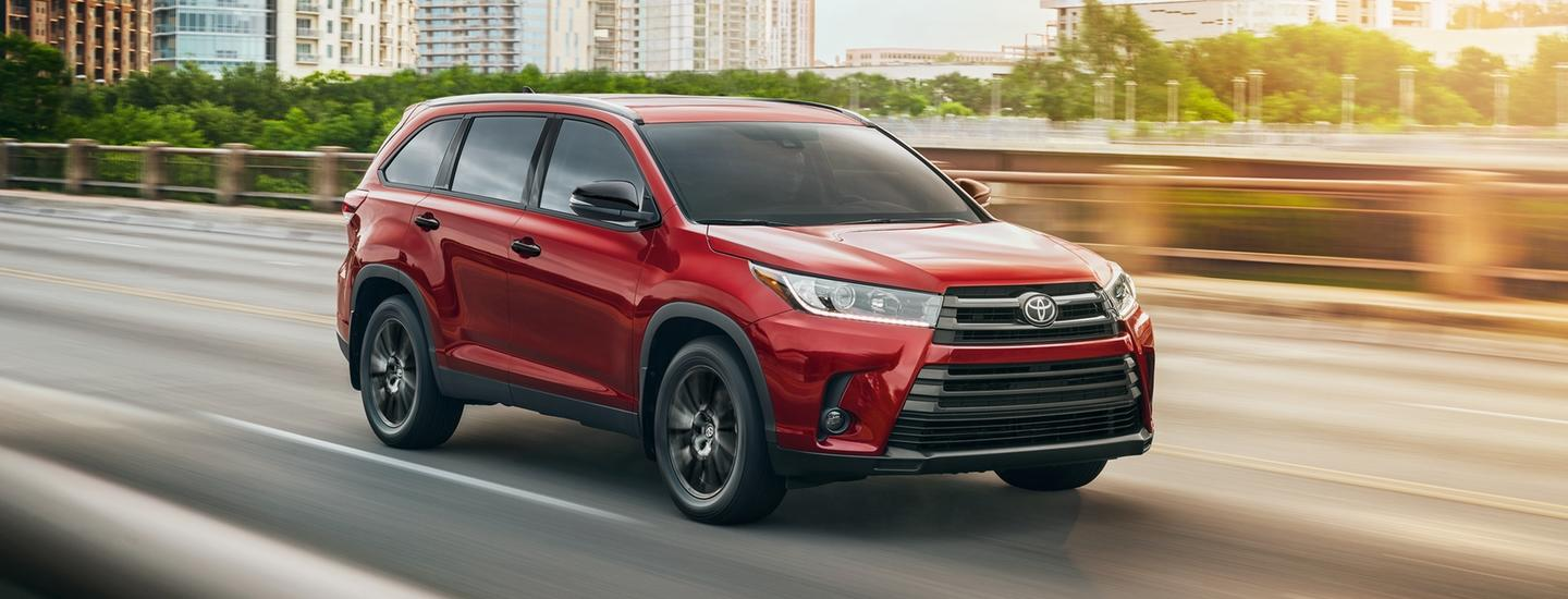 Red 2019 Toyota Highlander in motion