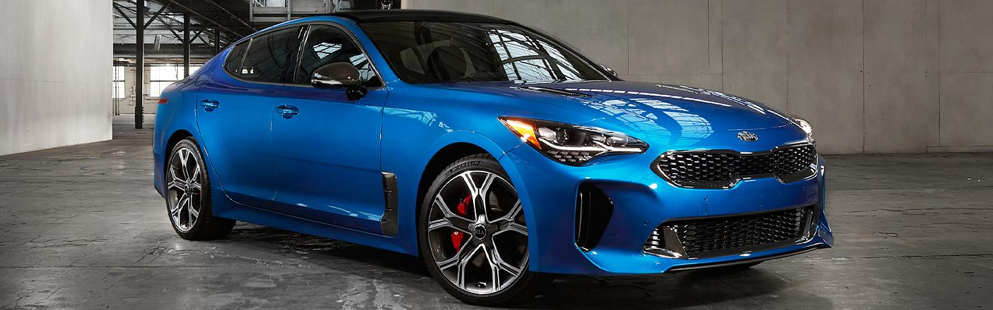 Blue Kia Stinger parked