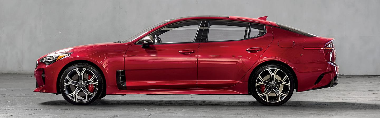 Red driver side profile of the Kia Stinger