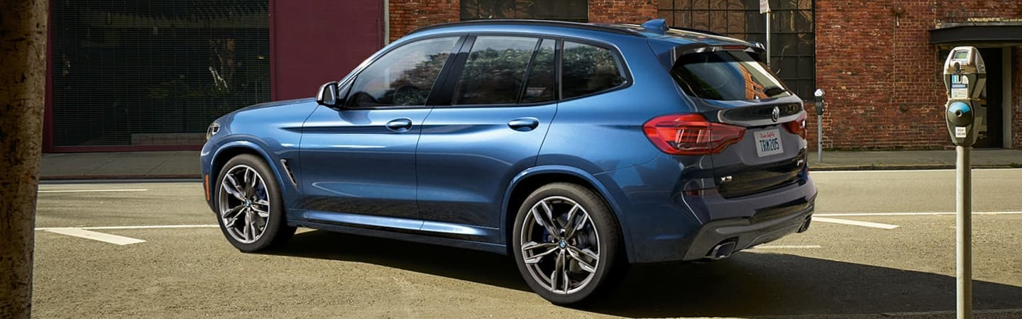 Rear view of the 2020 BMW X3 in motion