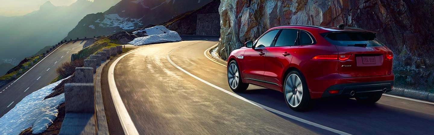 Side view of a 2020 Jaguar F-Pace in motion