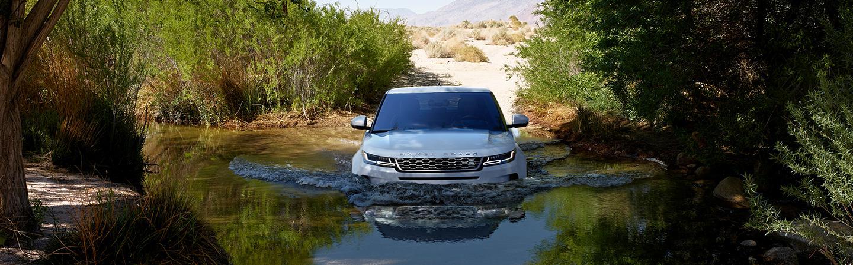 White 2020 Land Rover Range Rover Evoque driving through water