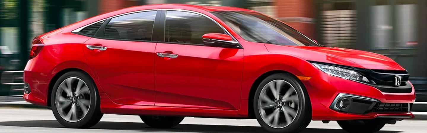Side view of red 2020 Honda Civic sedan in motion