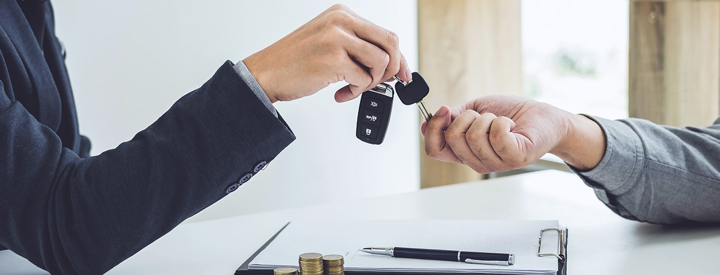 Salesman handing over keys to customer at our Audi Dealership near Tampa, FL