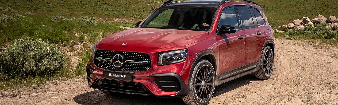 Red 2020 Mercedes-Benz GLB driving on a dirt road