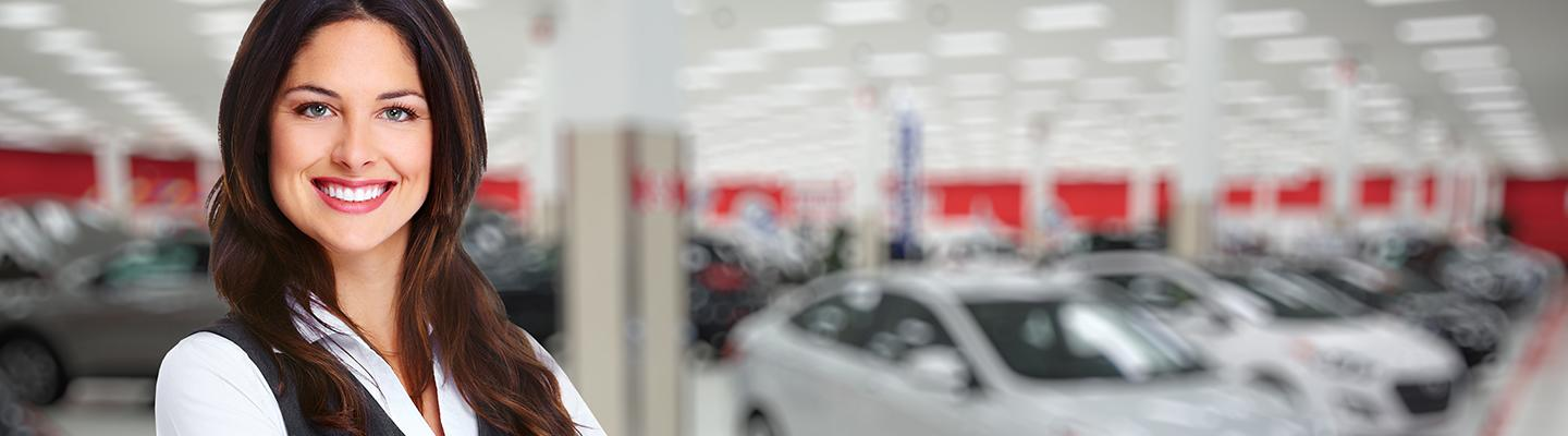 A woman standing in a Toyota service center!