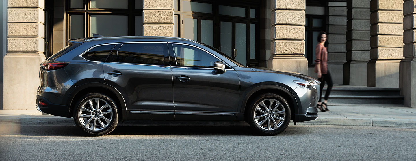 2019 Mazda CX-9 parked in city view of passenger side.