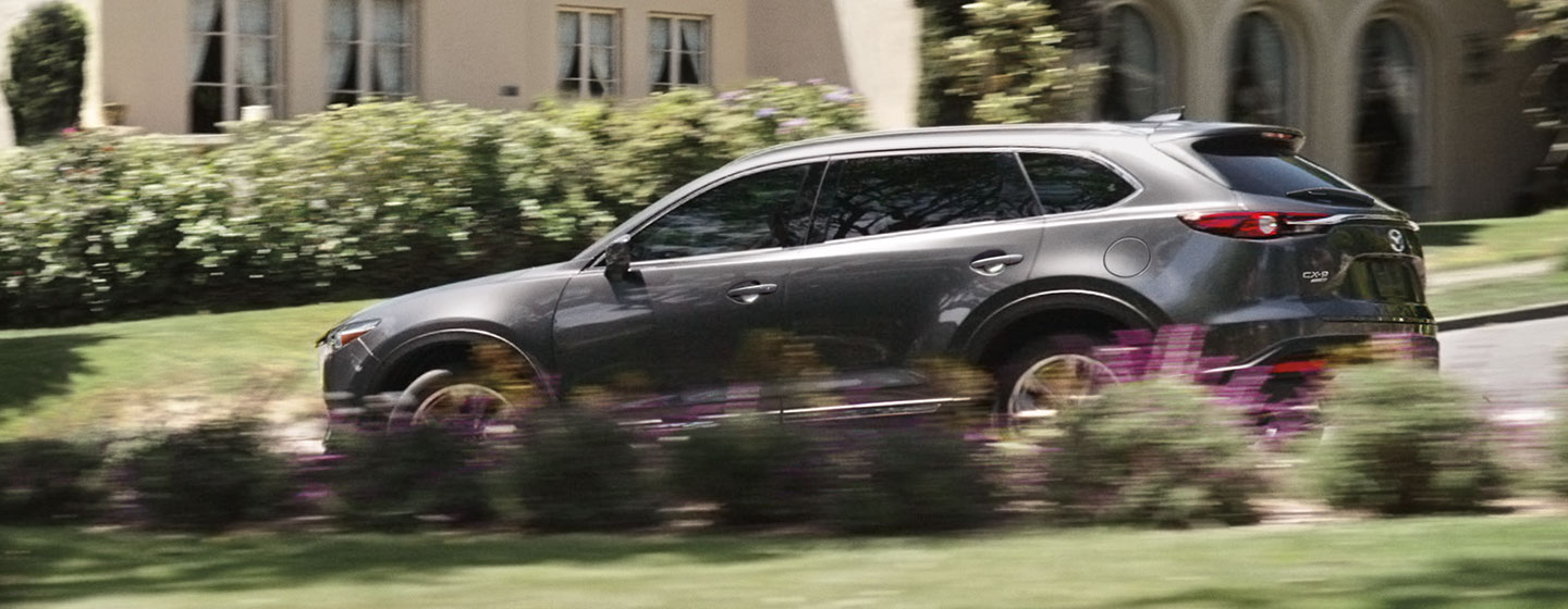 2019 Mazda CX-9 driver side in motion.